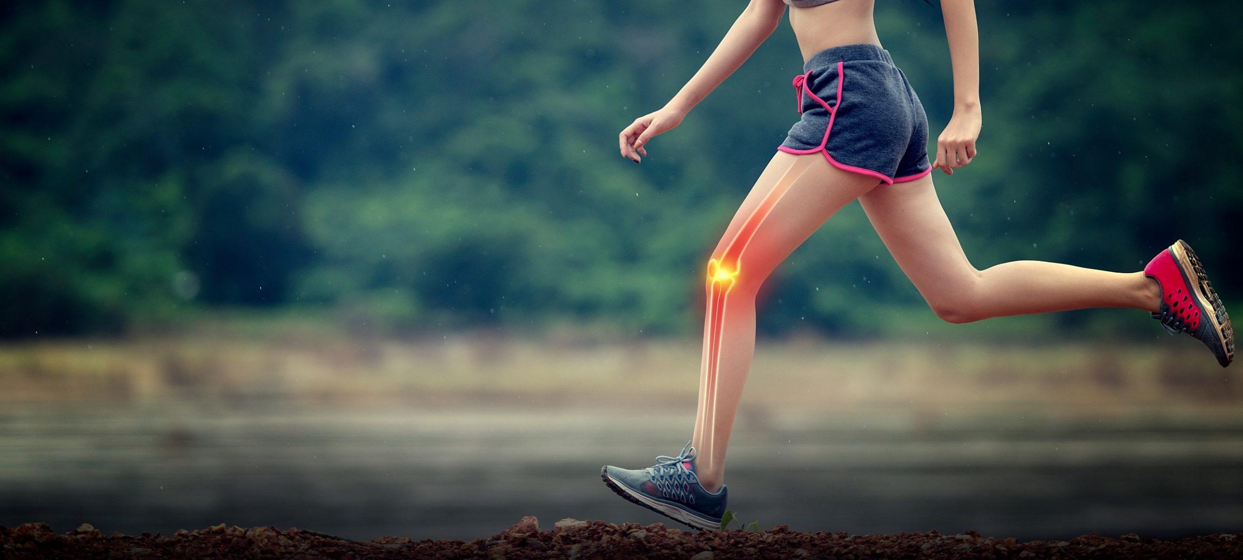 ragazza che fa sport con infiammazione al ginocchio